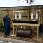 David Hart next to Backyard Hybrid System with Sahib Sandwich Towers hung